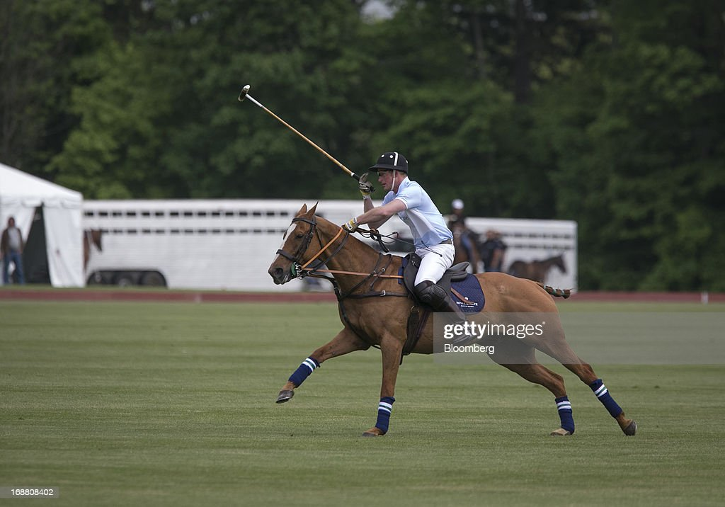 Prince Harry of Wales plays polo during the Sentebale Royal Salute Polo Cup at the Greenwich Polo Club in Greenwich, Connecticut, U.S., on Wednesday, May 15, 2013. Prince Harry's visit is part of a week-long U.S. tour that also includes stops in Washington, Colorado and New York. Photographer: Scott Eells/Bloomberg via Getty Images