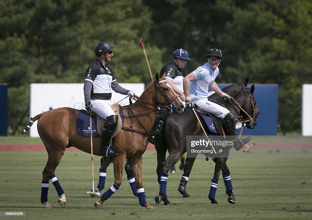 Prince Harry of Wales, right, plays polo during the Sentebale Royal Salute Polo Cup at the Greenwich Polo Club in Greenwich, Connecticut, U.S., on Wednesday, May 15, 2013. Prince Harry's visit is part of a week-long U.S. tour that also includes stops in Washington, Colorado and New York. Photographer: Scott Eells/Bloomberg via Getty Images