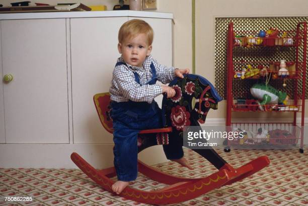 Prince Harry on a rocking horse in the playroom at Kensington Palace London 22nd October 1985