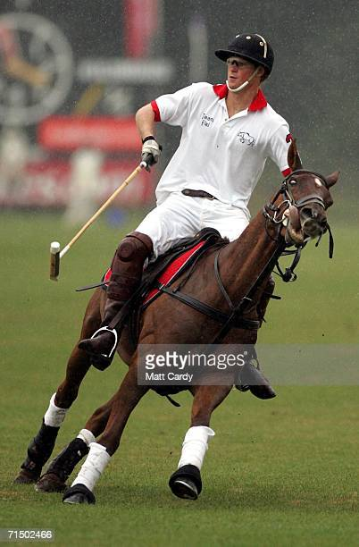 Prince Harry on horseback playing polo at Cirencester Park Polo Club on July 22 2006 in Cirencester England