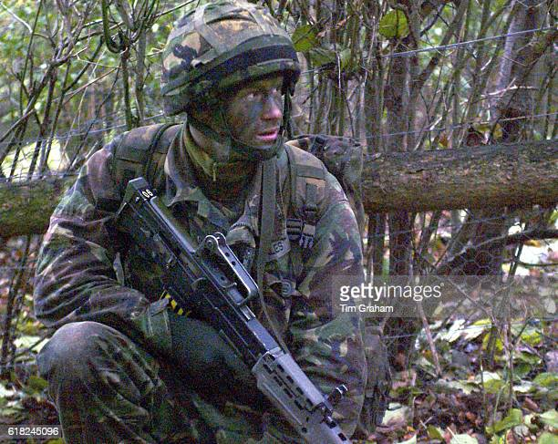 Prince Harry on military manoeuvres during his training at Sandhurst Military Academy, issued on January 25, 2006. Prince Harry is to join the Blues...
