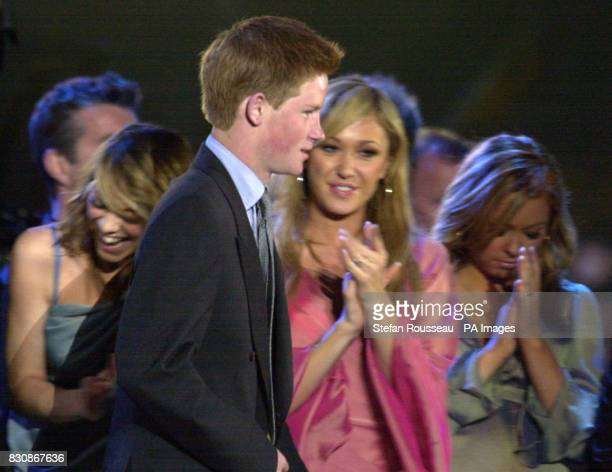 Prince Harry on stage in the gardens of Buckingham Palace for the second concert to commemorate the Golden Jubilee of Britain's Queen Elizabeth II *...