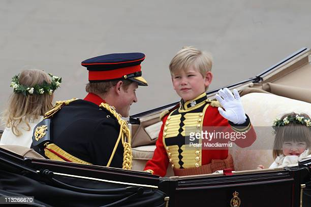 Prince Harry page boy Tom Pettifer and bridesmaid Eliza Lopes make the journey by carriage procession to Buckingham Palace following their marriage...