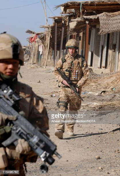 Prince Harry patrols the deserted town of Garmisir on January 2, 2008 in Helmand Province, Afghanistan.