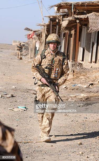 Prince Harry patrols through the deserted town of Garmisir on January 2, 2008 in Helmand Province, Afghanistan.