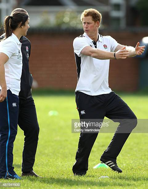 Prince Harry Patron of England Rugby's All Schools Programme jokes with Sarah Hunter as he plays touch rugby against schoolchildren during a teacher...