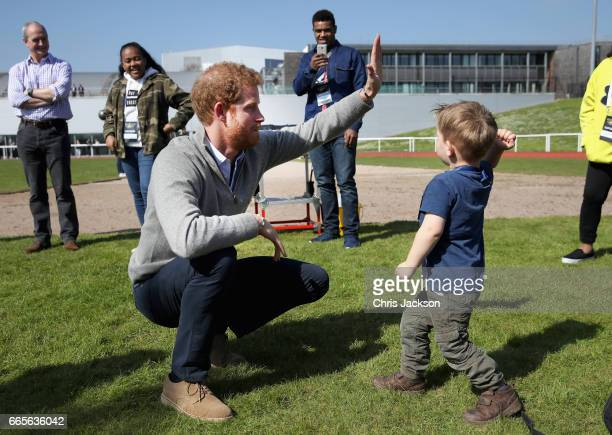 Prince Harry, Patron of the Invictus Games Foundation, plays with Harry Phillips, aged two and a half as he attends the UK team trials for the...