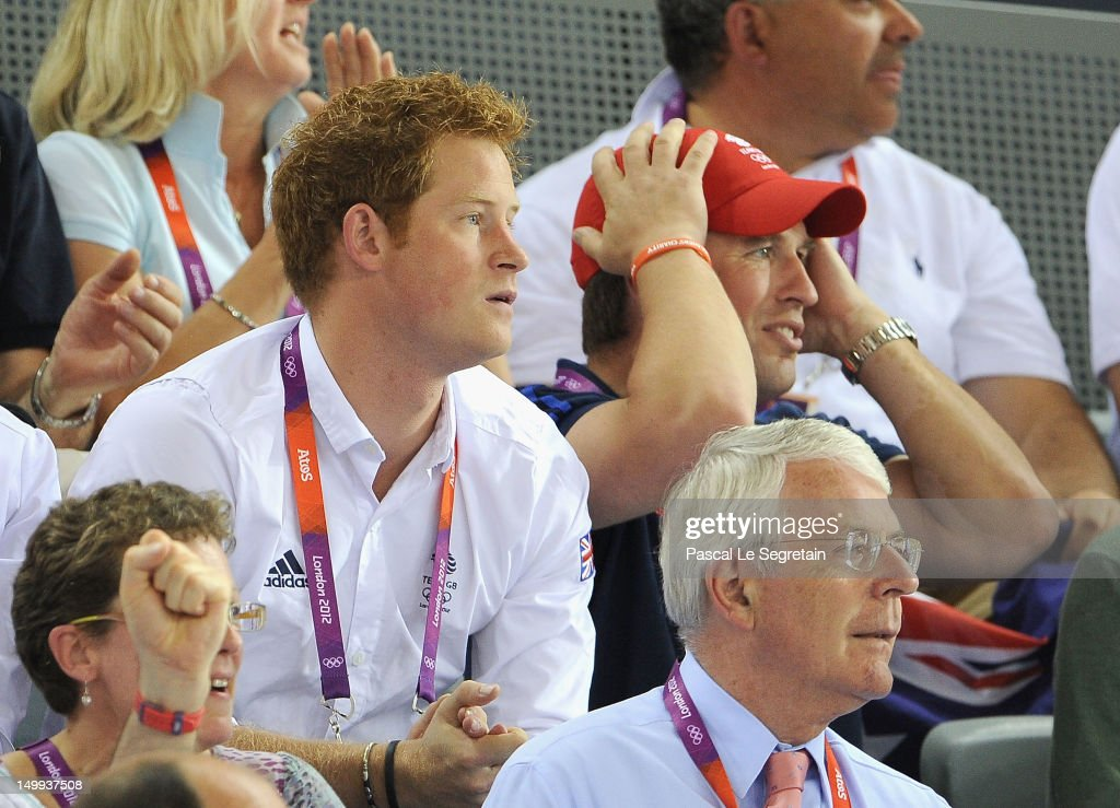 Prince Harry, Peter Phillips and former Prime Minister John Major (front) enjoy the atmosphere as they watch the Track Cycling on Day 11 of the London 2012 Olympic Games at the Velodrome on August 7, 2012 in London, England.