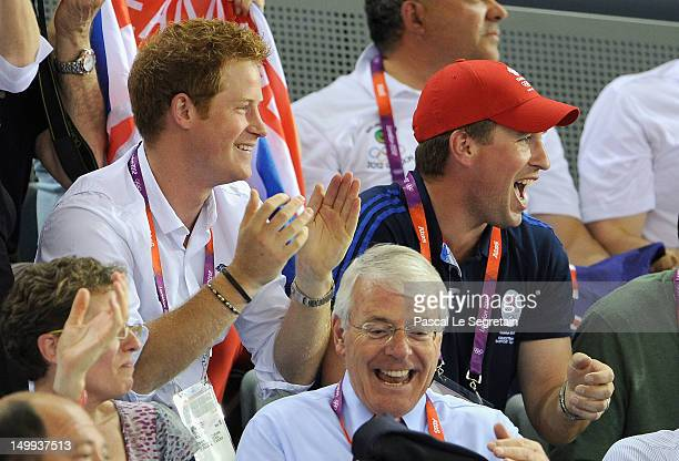 Prince Harry Peter Phillips and former Prime Minister John Major enjoy the atmosphere as they watch the Track Cycling on Day 11 of the London 2012...