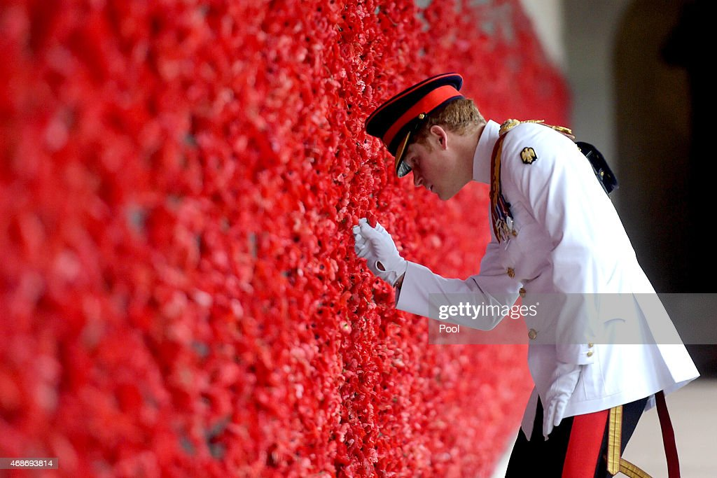 Prince Harry places a poppy at the Roll of Honour during a visit to the Australian War Memorial on April 6, 2015 in Canberra, Australia. Prince Harry, or Captain Wales as he is known in the British Army, will end his military career with a month long secondment to the Australian Defence Force in barracks in Sydney, Perth and Darwin.