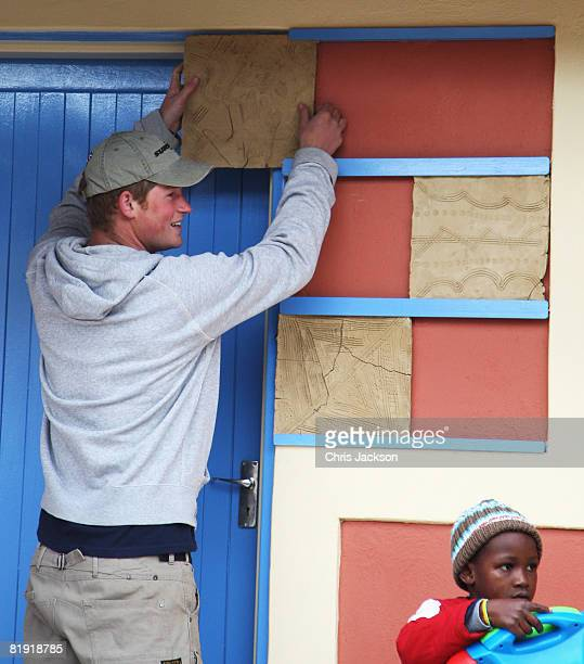 Prince Harry places a special tile he designed during a visit to LCCU on July 9 2008 in Maseru Lesotho Prince Harry and 26 soldiers from the...
