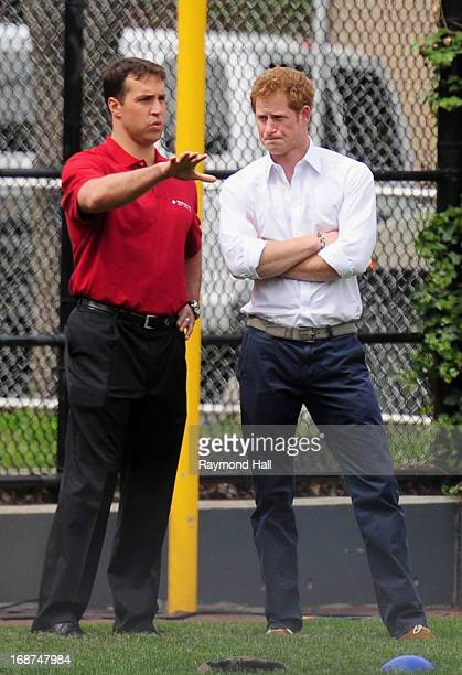 Prince Harry plays baseball at Harlem RBI Playground in Harlem on May 14 2013 in New York City