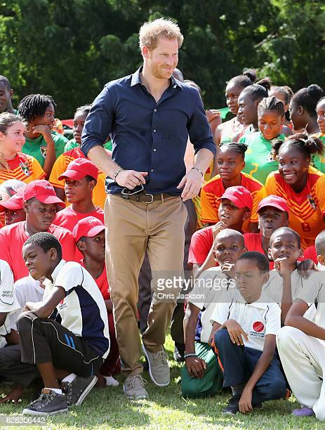 Prince Harry plays cricket as he attends a community sporting event at Queen Park Ground on the ninth day of an official visit to the Caribbean on...