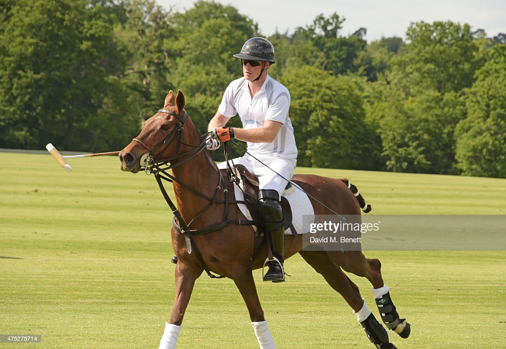 Prince Harry plays during day one of the Audi Polo Challenge at Coworth Park on May 30, 2015 in London, England.