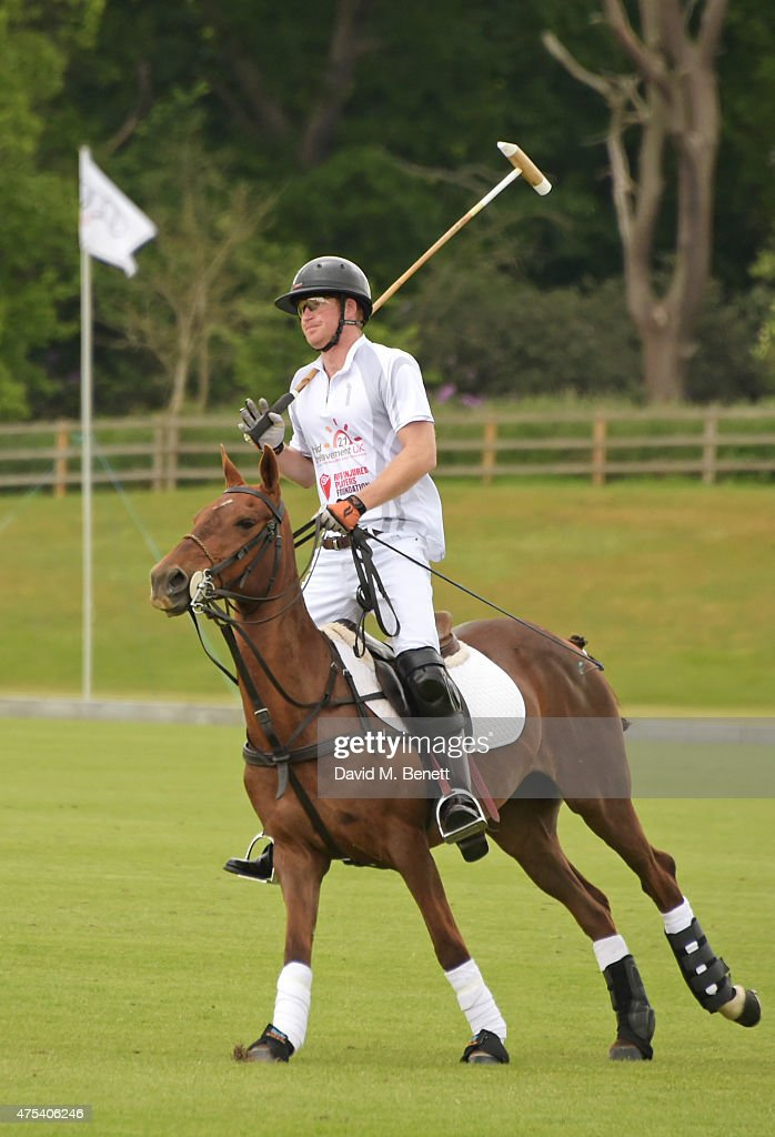 Prince Harry plays during day two of the Audi Polo Challenge at Coworth Park on May 31, 2015 in London, England.