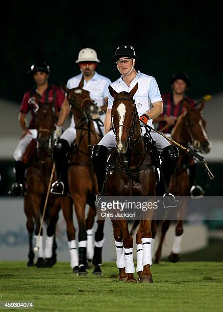 Prince Harry plays during the Sentebale Polo Cup presented by Royal Salute World Polo at Ghantoot Polo Club on November 20 2014 in Abu Dhabi United...