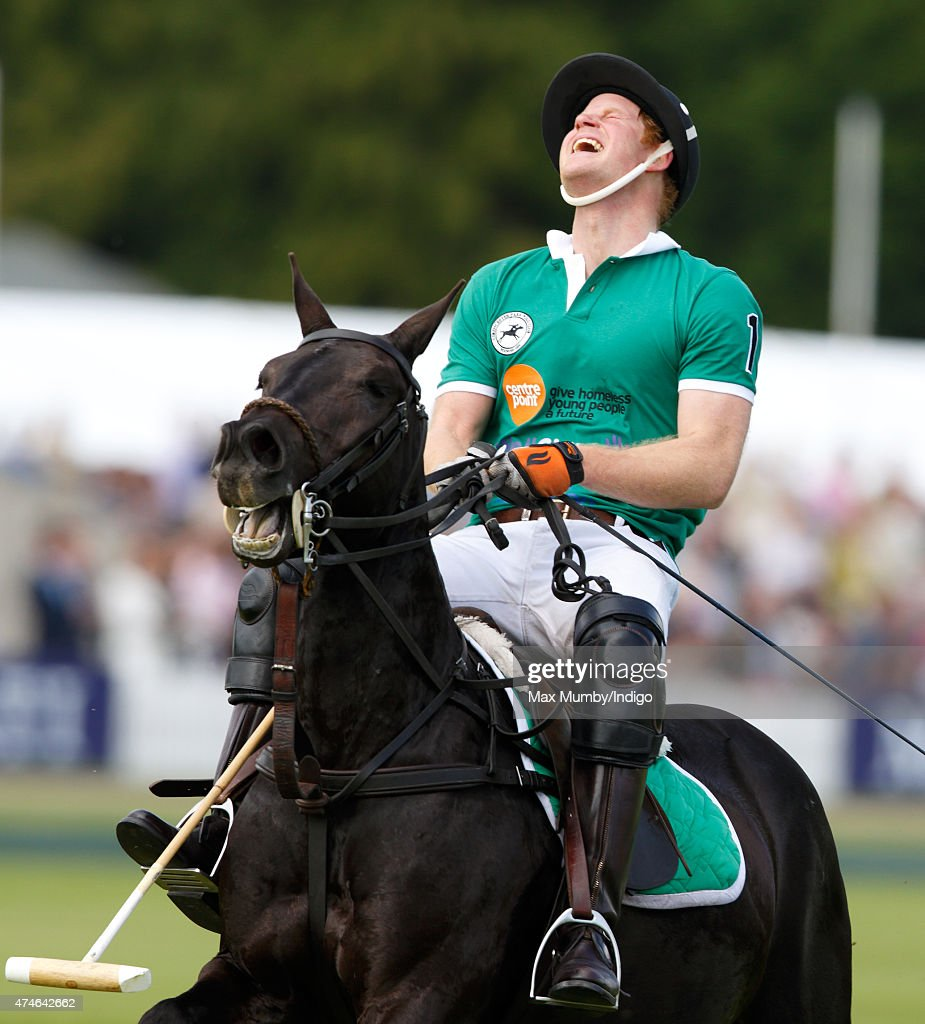 Prince Harry plays for Team BMG in the Maserati Jerudong Park Trophy polo match at Cirencester Park Polo Club on May 24, 2015 in Cirencester, England.