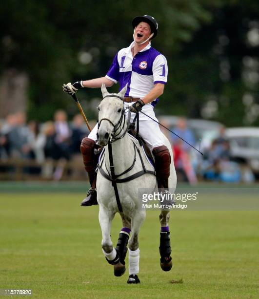 Prince Harry plays for team Cirencester Park in the Jerudong Park Trophy Final polo match at Cirencester Park Polo Club on June 5 2011 in Cirencester...