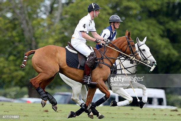 Prince Harry plays for team Royal Salute and Prince William Duke of Cambridge plays for team Piaget at the Gigaset Charity Polo Match at Beaufort...