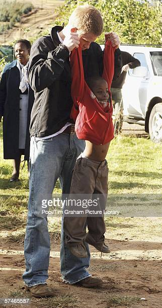 Prince Harry plays games with his old friend, Mutsu Potsane, in the grounds of the Mants'ase children's home, while on a return visit to Lesotho in...