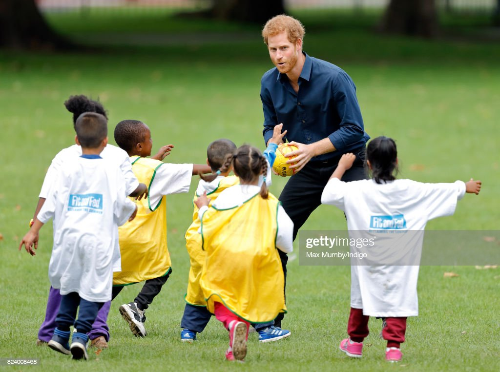 Prince Harry plays handball with children taking part in a StreetGames 'Fit and Fed' summer holiday activity session in Central Park, East Ham on July 28, 2017 in London, England. The Fit and Fed campaign aims to provide children and young people with free access to activity sessions, with lunch included, throughout the summer holidays.