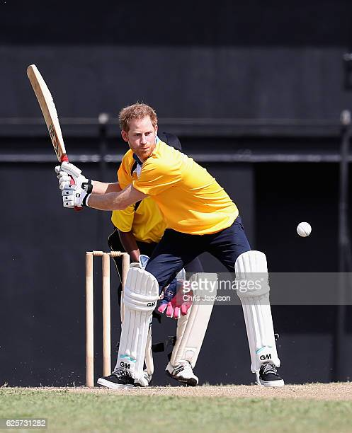 Prince Harry plays in a cricket match at the Darren Sammy Cricket Ground on the sixth day of an official visit on November 25 2016 in Castries Saint...