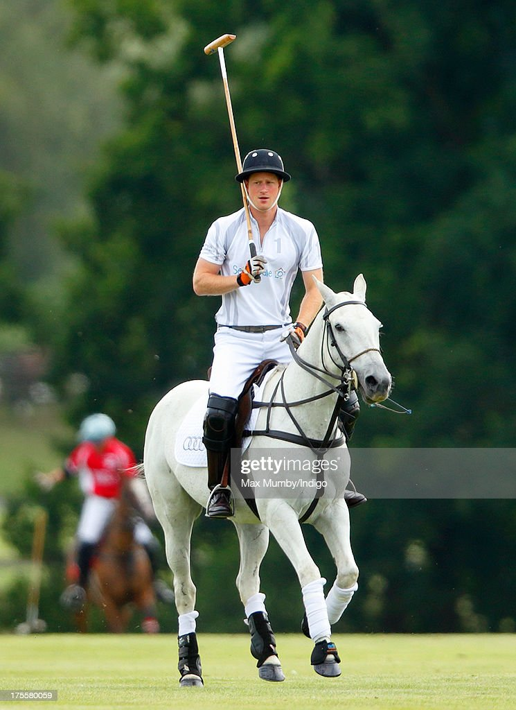 Prince Harry plays in the Audi Polo Challenge at Coworth Park Polo Club on August 4, 2013 in Ascot, England.