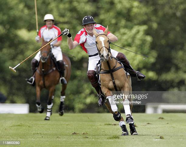 Prince Harry plays in the Audi Polo Challenge polo match for team Sentebale versus team Audi at Coworth Park Polo Club on May 8 2011 in Ascot England