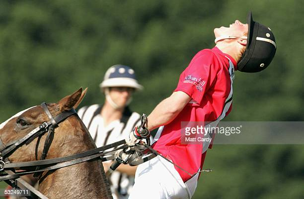 Prince Harry plays polo at the Final Queen Mother Trophy Corinium Bowl Doug Brown Cup Matches at Cirencester Park Polo Club on July 17 2005 in...