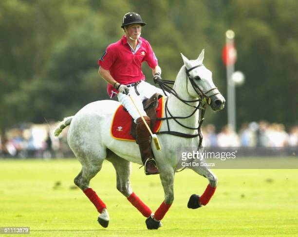 Prince Harry plays polo at the Guards Polo Club in the Cartier Golden Jubilee Polo Match against Hurlingham July 25th 2004 in Windsor England