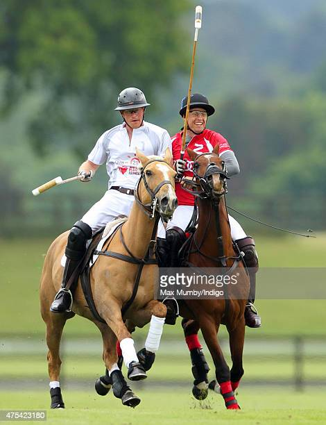 Prince Harry plays polo on day 2 of the Audi Polo Challenge at Coworth Park on May 31 2015 in Ascot England