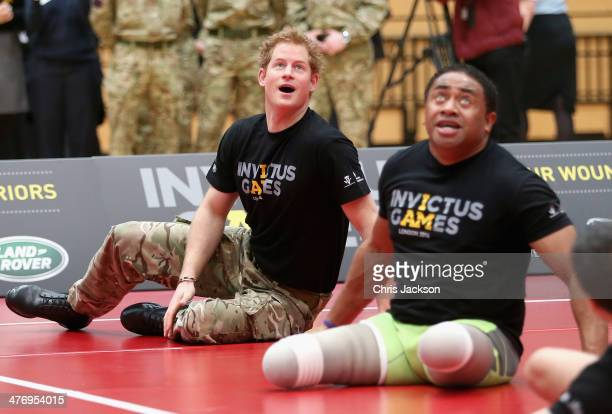 Prince Harry plays sitting Volley Ball as he takes part in a match at the media launch for the Invictus Games 2014 at the Copper Box Arena in the...