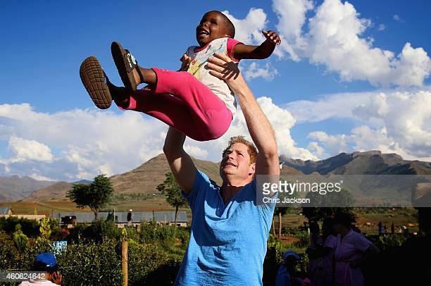 Prince Harry plays with a three year old blind girl called Karabo during a visit to Phelisanong Children's Home on December 6 2014 in Pitseng Lesotho...