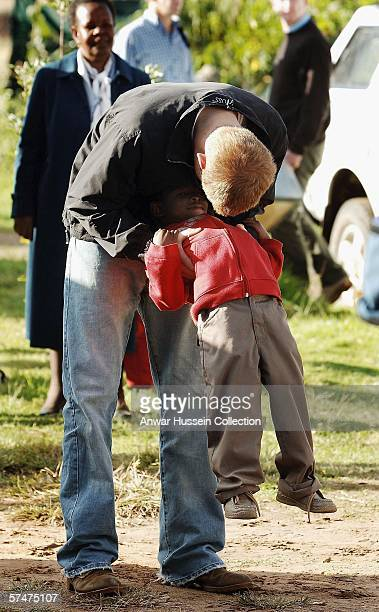 Prince Harry plays with an old friend, Mutsu Potsane, in the grounds of the Mants'ase children's home while on a return visit to Lesotho on April 24,...