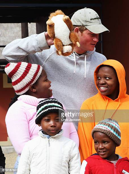 Prince Harry plays with children during a visit to LCCU on July 9, 2008 in Maseru, Lesotho. Prince Harry and 26 soldiers from the Household Cavalry...