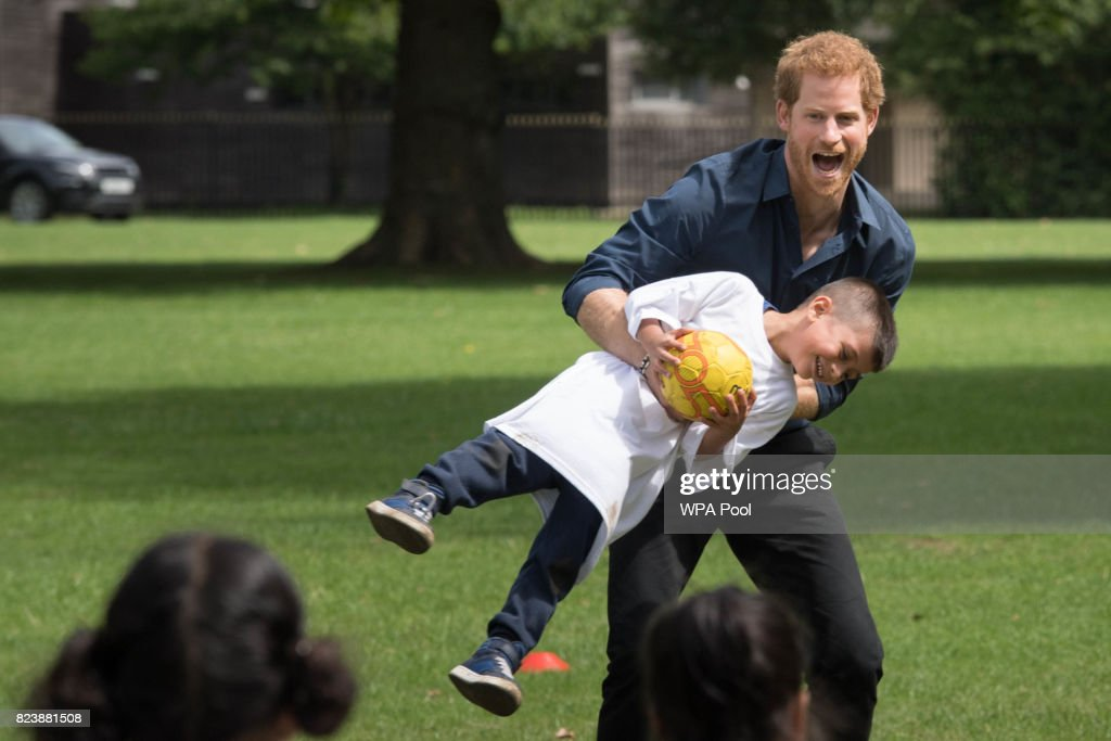 Prince Harry plays with children during a visit to StreetGames' Fit and Fed at Central Park East Ham on July 28, 2017 in London, England. The session which forms part of the Fit and Fed campaign aims to provide children and young people with access to activity sessions during the summer.