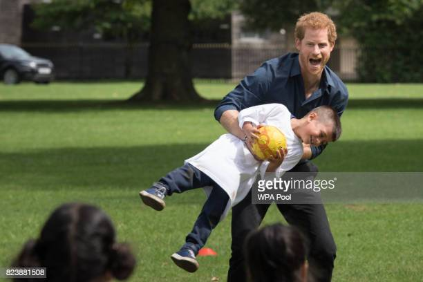 Prince Harry plays with children during a visit to StreetGames' Fit and Fed at Central Park East Ham on July 28 2017 in London England The session...