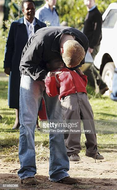 Prince Harry plays with his old friend, Mutsu Potsane, in the grounds of the Mants'ase children's home, while on a return visit to Lesotho in...