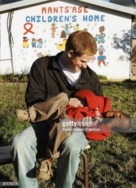 Prince Harry plays with Mutsu Potsane in the grounds of the Mants'ase children's home while on a return visit to Lesotho on April 24, 2006 in...