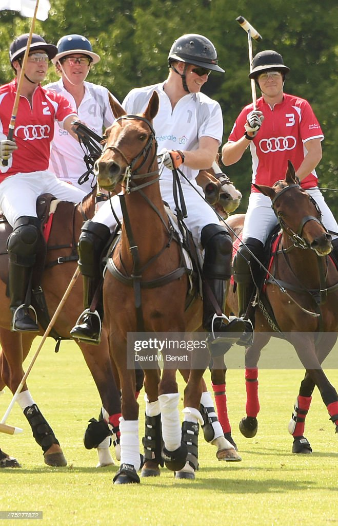 Prince Harry (2R) plays with Ollie Cudmore, Luke Tomlinson and Max Charlton during day one of the Audi Polo Challenge at Coworth Park on May 30, 2015 in London, England.
