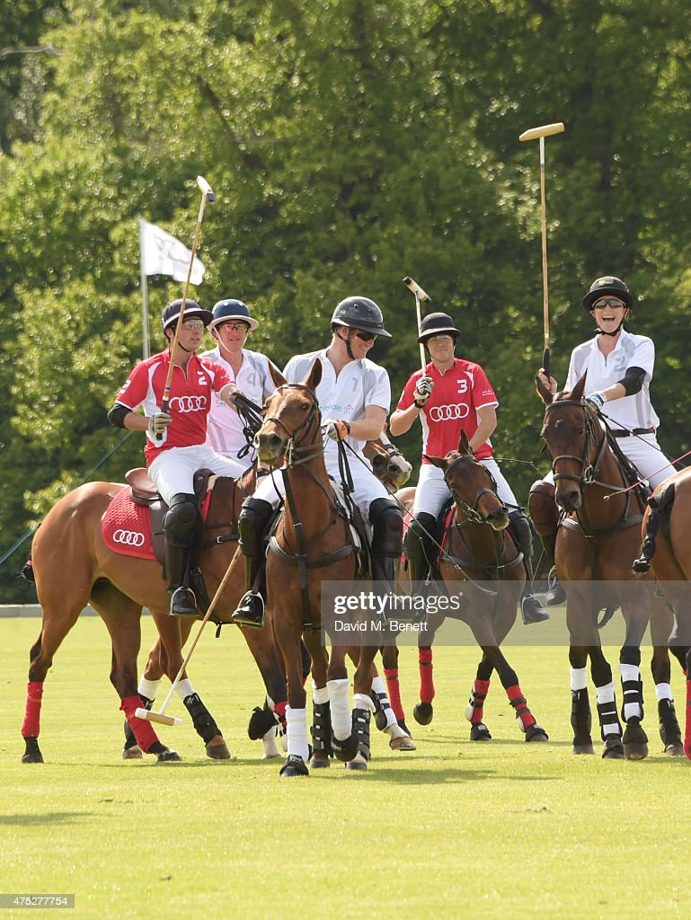 Prince Harry (C) plays with Ollie Cudmore, Luke Tomlinson, Max Charlton and Nina Clarkin during day one of the Audi Polo Challenge at Coworth Park on May 30, 2015 in London, England.