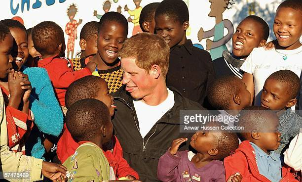 Prince Harry pokes his tongue out at Mutsu Potsane, in the grounds of the Mants'ase childrens home, while on a return visit to Lesotho on April 24,...