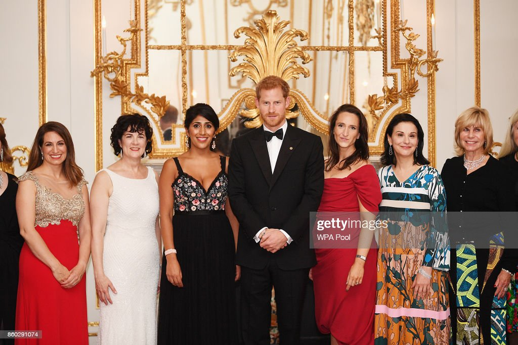 Prince Harry poses for a photo with Amanda Pullinger, Chief Executive Officer of 100 Women in Finance (2R) and Sonia Gardner (2L) as he attends 100 Women in Finance Gala Dinner in aid of Wellchild at the Victoria and Albert Museum on October 11, 2017 in London, England.