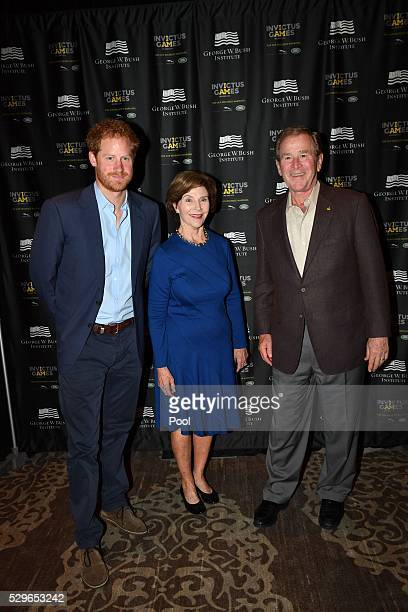 Prince Harry poses for a photo with Laura Bush and George W Bush during the Opening Ceremony of the Invictus Games Orlando 2016 at ESPN Wide World of...