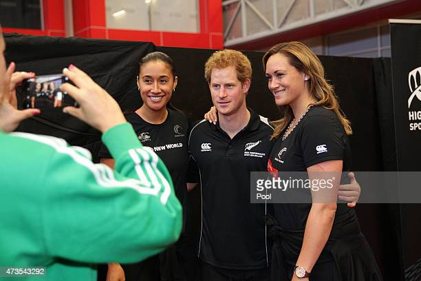 Prince Harry poses for a photo with New Zealand Netballers Maria Tutaia and Cathrine Latu visits the AUT Millenium Institute on May 16 2015 in...