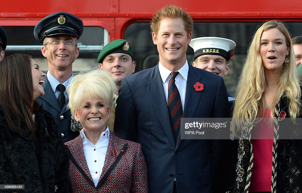 Prince Harry (2nd-R) poses for a photo with supporters of the Royal British Legion's London Poppy Day appeal with Joss Stone (R), Barbara Windsor (2nd-L) and Lacey Turner (L) before getting on board the poppy bus at Buckingham Palace on October 30, 2014 in London, England. The 1960s Routemaster bus today is carrying war veterans and celebrity supporters including Joss Stone and Barbara Windsor around London and will later meet the Prime Minister David Cameron.
