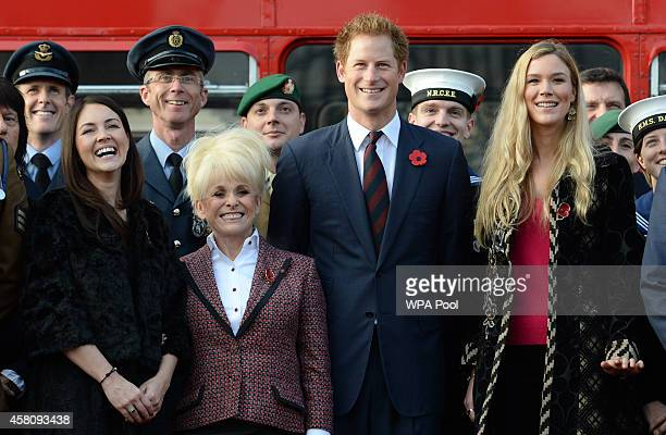 Prince Harry poses for a photo with supporters of the Royal British Legion's London Poppy Day appeal with Joss Stone Barbara Windsor and Lacey Turner...