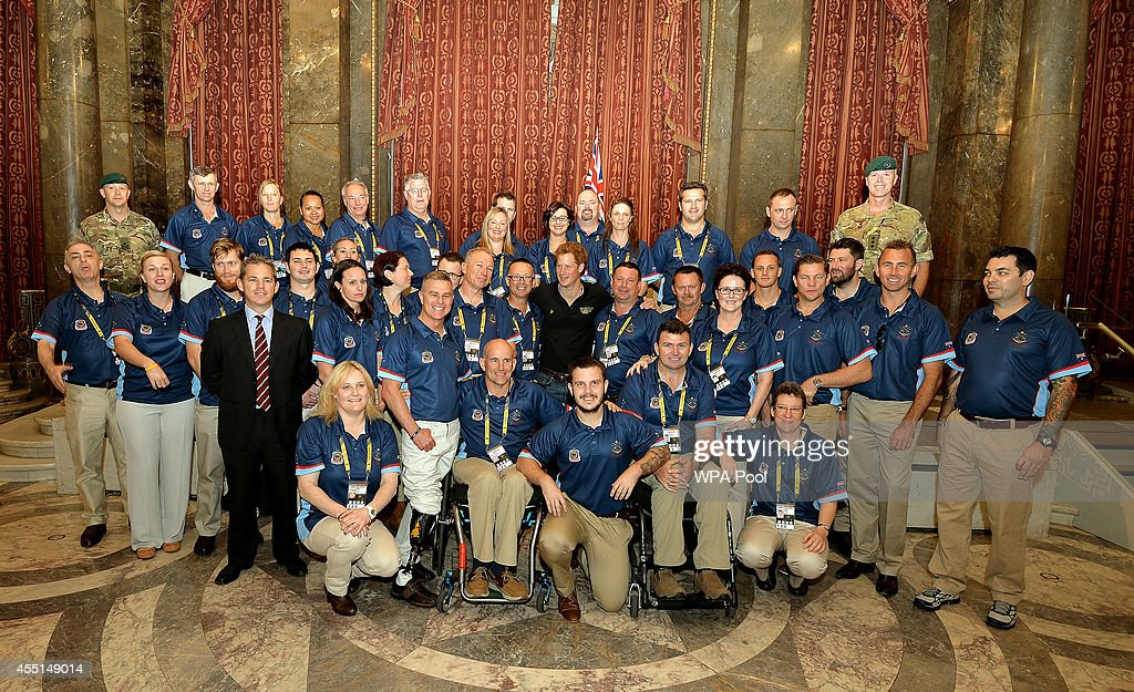Prince Harry poses for a photo with the Australian Invictus team before they compete at the games over the next five days at Australia House on September 10, 2014 in London, England.