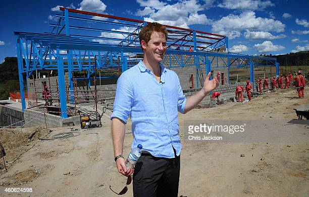 Prince Harry poses for a photograph in front of the dining room at the construction site for the new Mamohato Children's Centre at ThabaBosiu on...