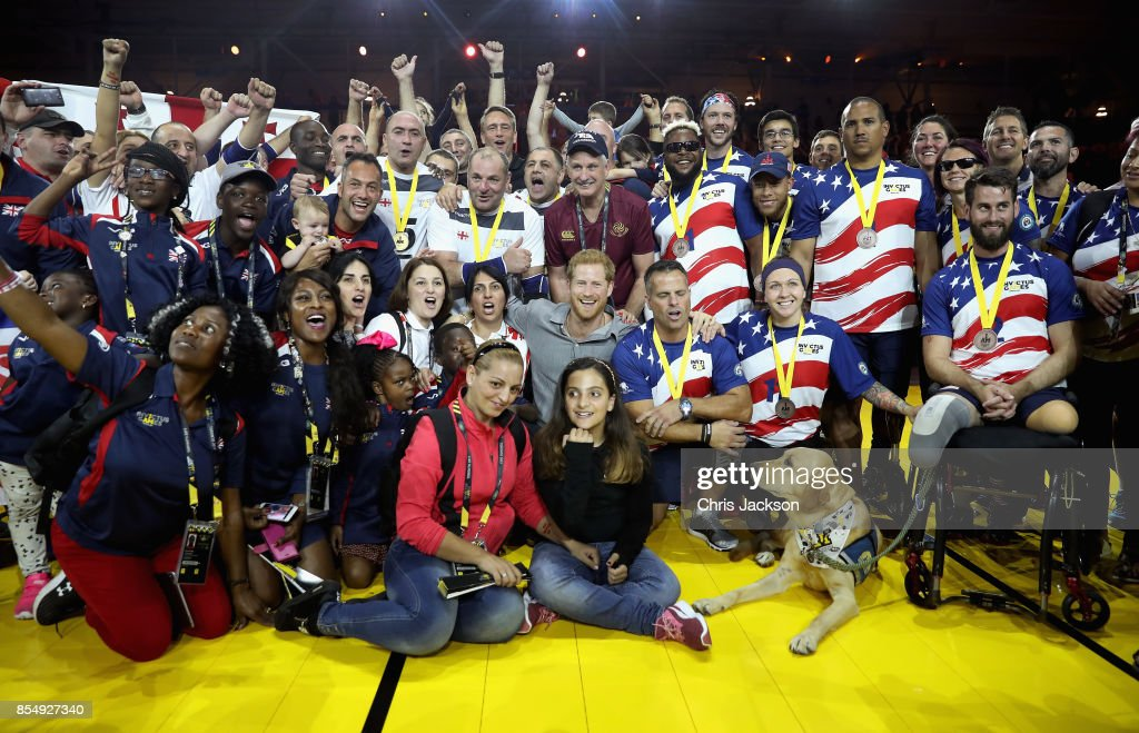 Prince Harry poses for a photograph with the UK Armed Forces Team, Georgian Team and USA Team after the Sitting Volleyball Finals during the Invictus Games 2017 at Mattamy Athletic Centre on September 27, 2017 in Toronto, Canada.